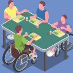 инвалиды в колясках за столом