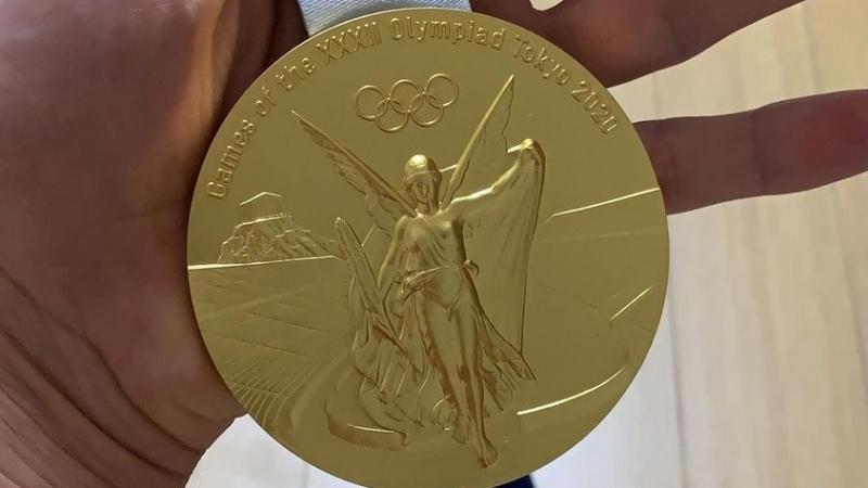 золотая олимпийская медаль Токио